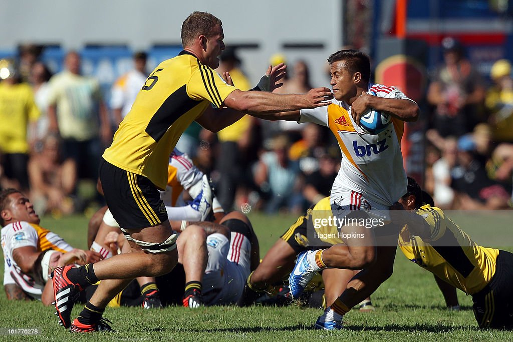 Tim Nanai-Williams of the Chiefs fends James Broadhurst of the Hurricanes during the Super Rugby trial match between the Hurricanes and the Chiefs at Mangatainoka RFC on February 16, 2013 in Mangatainoka, New Zealand.