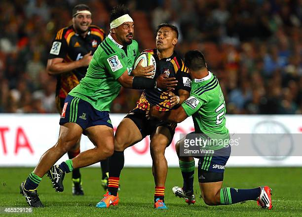 Tim NanaiWilliams of the Chiefs runs into the tackle of Ash Dixon of the Highlanders during the round four Super Rugby match between the Chiefs and...