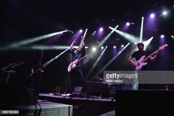 Tim Nordwind Damian Kulash and Andy Ross of OK GO perform onstage during the 2017 Firefly Music Festival on June 16 2017 in Dover Delaware