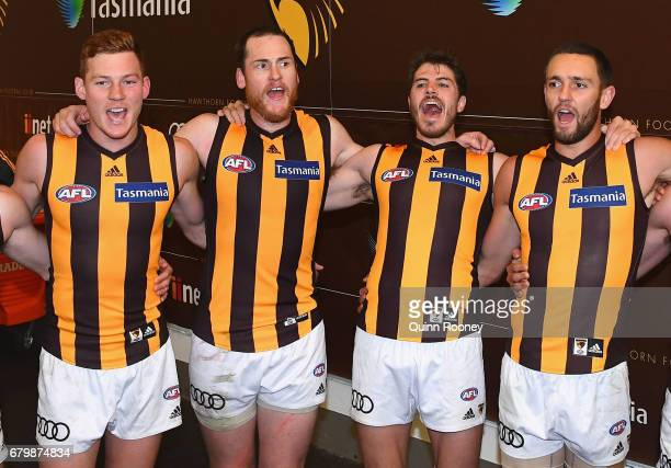 Tim O'Brien Jarryd Roughead Isaac Smith and Jack Gunston of the Hawks sing the song in the rooms after winning the round seven AFL match between the...