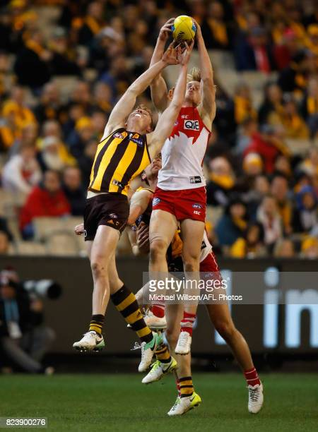 Tim O'Brien of the Hawks and Callum Mills of the Swans compete for the ball during the 2017 AFL round 19 match between the Hawthorn Hawks and the...