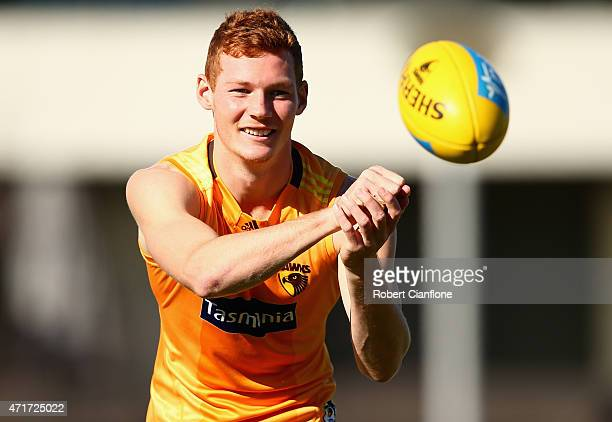 Tim O'Brien of the Hawks handballs during a Hawthorn Hawks AFL media session at Waverley Park on May 1 2015 in Melbourne Australia