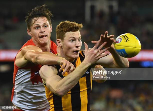 Tim O'Brien of the Hawks marks infront of Callum Sinclair of the Swans during the round 19 AFL match between the Hawthorn Hawks and the Sydney Swans...
