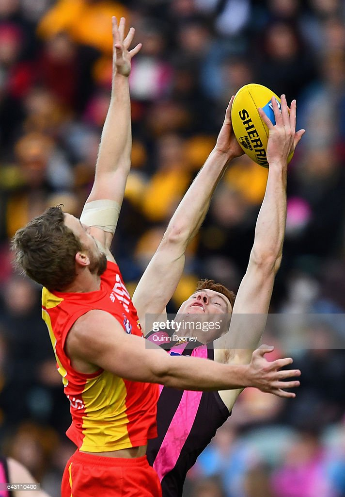 Tim O'Brien of the Hawks marksinfront of Trent McKenzie of the Suns during the round 14 AFL match between the Hawthorn Hawks and the Gold Coast Suns at Aurora Stadium on June 26, 2016 in Launceston, Australia.