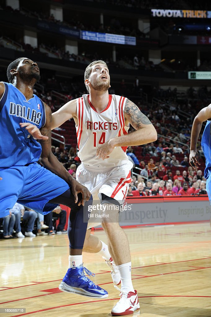 <a gi-track='captionPersonalityLinkClicked' href=/galleries/search?phrase=Tim+Ohlbrecht&family=editorial&specificpeople=4337144 ng-click='$event.stopPropagation()'>Tim Ohlbrecht</a> #14 of the Houston Rockets battles for positioning against <a gi-track='captionPersonalityLinkClicked' href=/galleries/search?phrase=Bernard+James&family=editorial&specificpeople=7387529 ng-click='$event.stopPropagation()'>Bernard James</a> #5 of the Dallas Mavericks on March 3, 2013 at the Toyota Center in Houston, Texas.