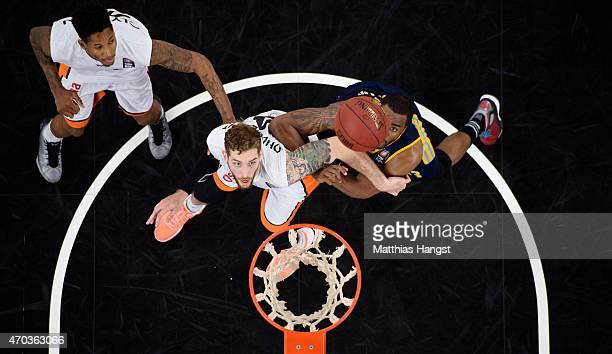 Tim Ohlbrecht of Ulm and Jamel McLean of Berlin look fot the ball during the Beko Basketball Bundesliga match between Ratiopharm Ulm and Alba Berlin...