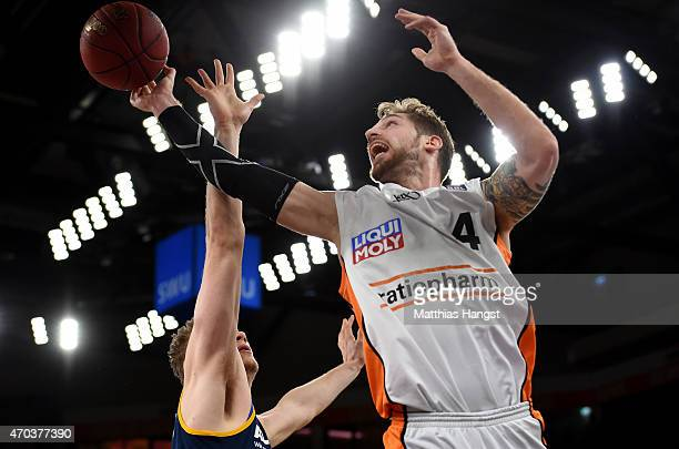 Tim Ohlbrecht of Ulm is challenged by Leon Radosevic of Berlin during the Beko Basketball Bundesliga match between Ratiopharm Ulm and Alba Berlin at...
