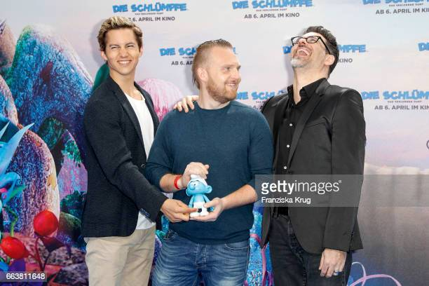 Tim Oliver Schultz Axel Stein and Rick Kavanian attend 'Die Schluempfe Das verlorene Dorf' Berlin Premiere at Sony Centre on April 2 2017 in Berlin...