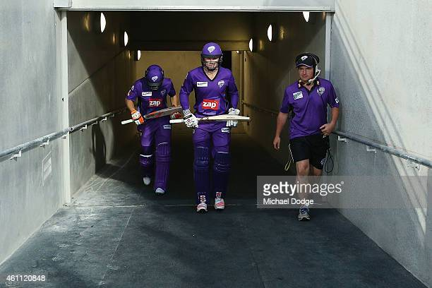 Tim Paine and Ben Dunk of the Hurricanes walk onto the field of play to start their innings during the Big Bash League match between the Hobart...