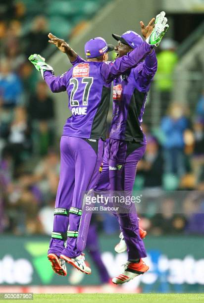 Tim Paine and Darren Sammy of the Hurricanes celebrate as they win the Big Bash League match between the Hobart Hurricanes and the Sydney Thunder at...