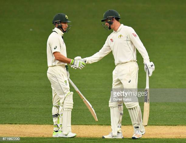 Tim Paine of CA XI is congratulated by Matthew Short of CA XI after reaching his half century during day two of the Four Day Tour match between the...