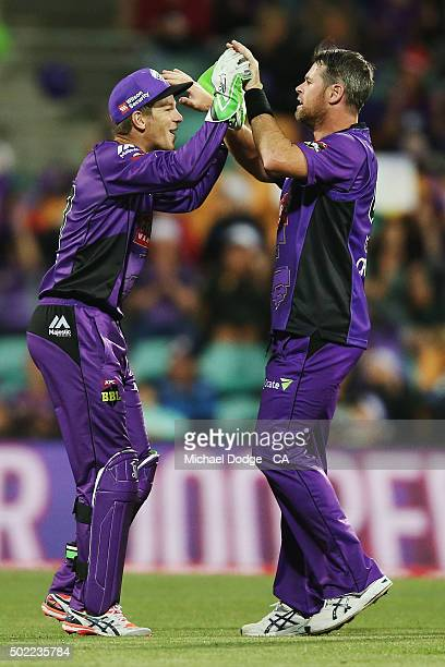 Tim Paine of the Hurricanes and Dan Christian celebrate a wicket during the Big Bash League match between Hobart Hurricanes and Brisbane Heat at...