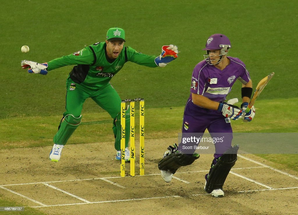 Tim Paine of the Hurricanes bats as Stars wicketkeeper Matthew Wade looks on during the Big Bash League Semi Final match between the Melbourne Stars and the Hobart Hurricanes at Melbourne Cricket Ground on February 4, 2014 in Melbourne, Australia.