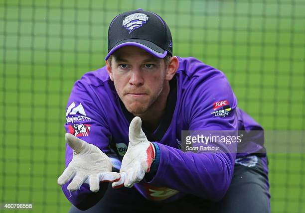 Tim Paine of the Hurricanes practices his wicketkeeping during the Big Bash League match between the Hobart Hurricanes and the Sydney Sixers at...