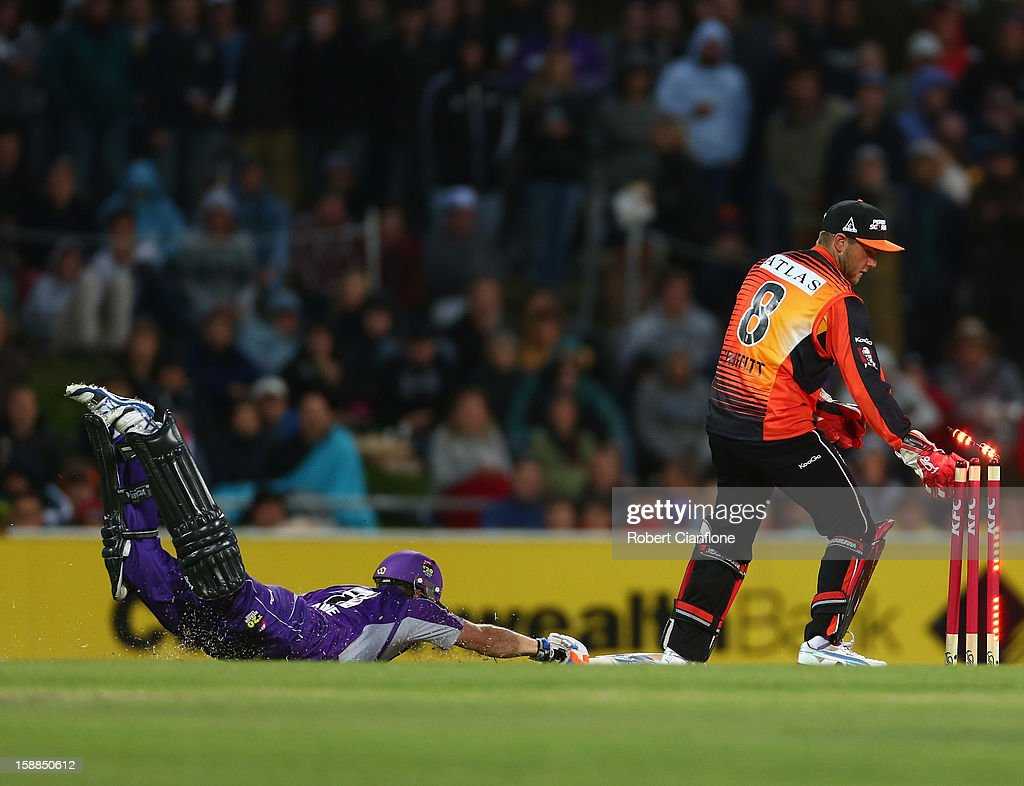 Tim Paine of the Hurricanes survis a runout attempt from Tom Triffitt of the Scorchers during the Big Bash League match between the Hobart Hurricanes and the Perth Scorchers at Blundstone Arena on January 1, 2013 in Hobart, Australia.