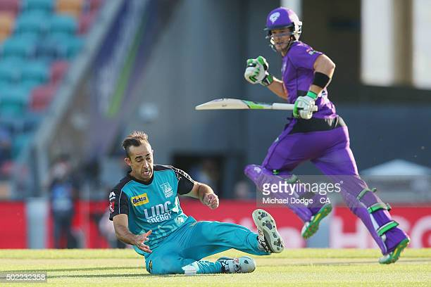 Tim Paine of the Hurricanes takes a run as Josh Lalor of the Heat fields the ball during the Big Bash League match between Hobart Hurricanes and...