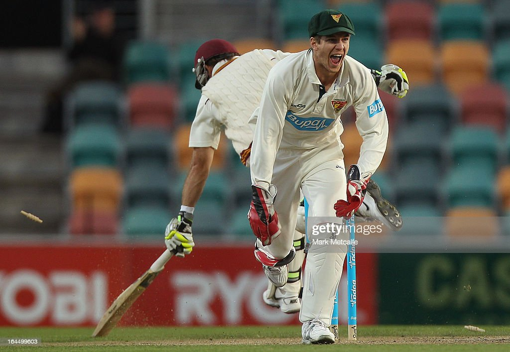 <a gi-track='captionPersonalityLinkClicked' href=/galleries/search?phrase=Tim+Paine&family=editorial&specificpeople=3990549 ng-click='$event.stopPropagation()'>Tim Paine</a> of the Tigers celebrates running out <a gi-track='captionPersonalityLinkClicked' href=/galleries/search?phrase=Chris+Hartley&family=editorial&specificpeople=185229 ng-click='$event.stopPropagation()'>Chris Hartley</a> of the Bulls off the bowling of James Faulkner during day three of the Sheffield Shield final between the Tasmania Tigers and the Queensland Bulls at Blundstone Arena on March 24, 2013 in Hobart, Australia.