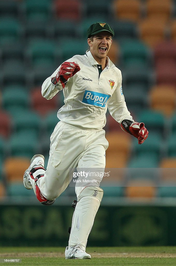 Tim Paine of the Tigers celebrates running out Chris Hartley of the Bulls off the bowling of James Faulkner during day three of the Sheffield Shield final between the Tasmania Tigers and the Queensland Bulls at Blundstone Arena on March 24, 2013 in Hobart, Australia.