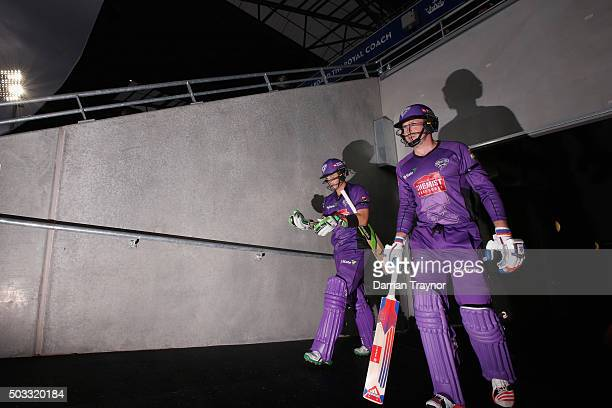 Tim Payne and Ben Dunk of the Hobart Hurricanes walk out to bat before the Big Bash League match between the Hobart Hurricanes and the Melbourne...