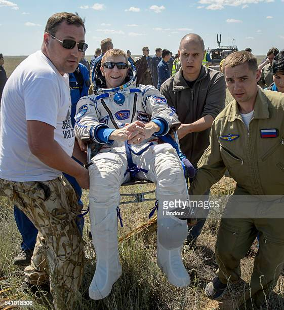 Tim Peake of the European Space Agency is carried to a medical tent after he and Tim Kopra of NASA and and Yuri Malenchenko of Roscosmos landed in...