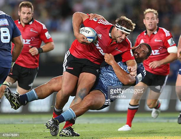 Tim Perry of the Crusaders fends off Charlie Faumuina of the Blues during the round three Super Rugby match between the Auckland Blues and the...