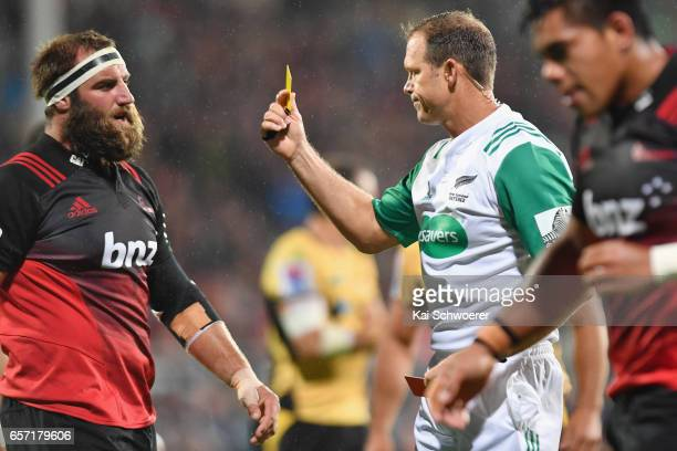 Tim Perry of the Crusaders is shown a yellow card by Referee Rohan Hoffmann during the round five Super Rugby match between the Crusaders and the...