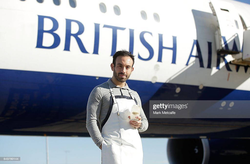 Tim Philips poses with a cocktail in front of a British Airways 777-300 on June 30, 2016 in Sydney, Australia. Jessie J played an acoustic set for VIPs and competition winners to celebrate the arrival of summer in the UK.