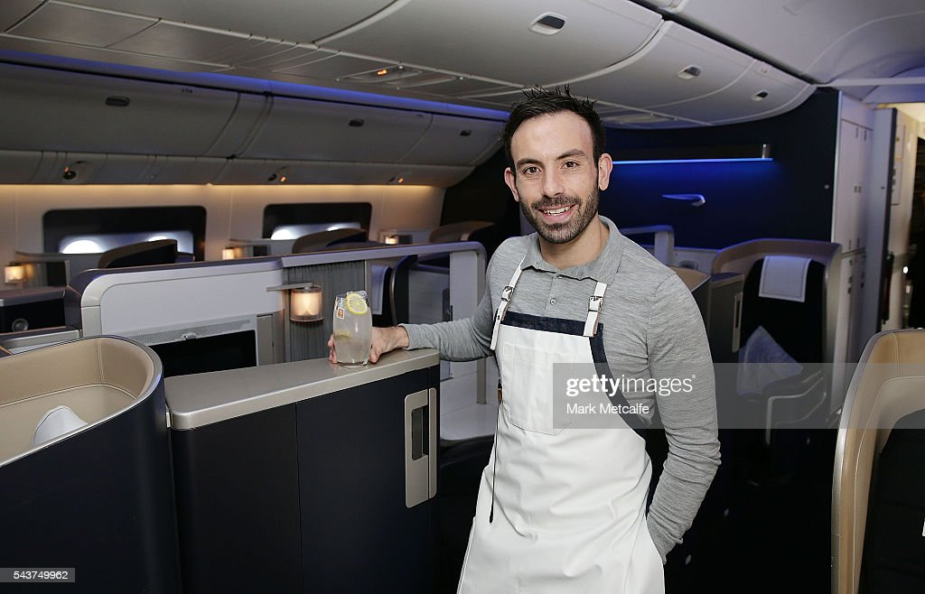 Tim Philips poses with a cocktail on a British Airways 777-300 on June 30, 2016 in Sydney, Australia. Jessie J played an acoustic set for VIPs and competition winners to celebrate the arrival of summer in the UK.