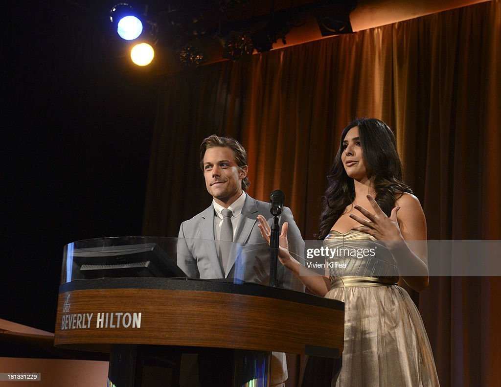 Tim Pocock and Camila Banus present the award for Youth Theatrical Agent of the Year at the 12th Annual Heller Awards at The Beverly Hilton Hotel on September 19, 2013 in Beverly Hills, California.