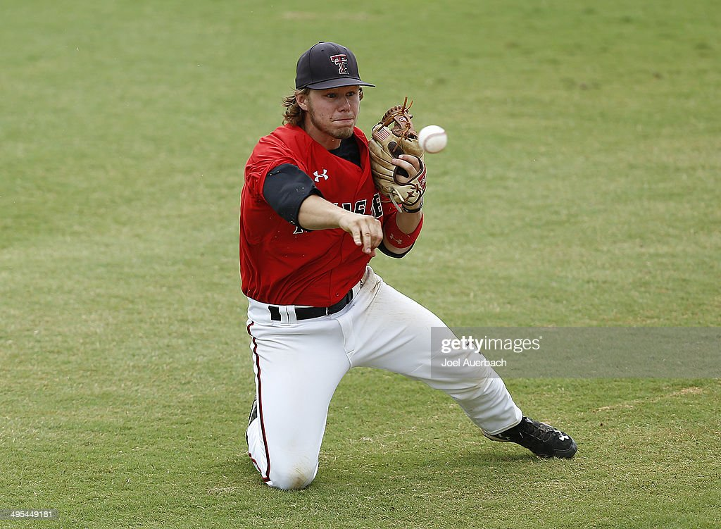 Tim Proudfoot of the Texas Tech Red Raiders throws the ball to third base against the Miami Hurricanes in the ninth inning during the Coral Gables...