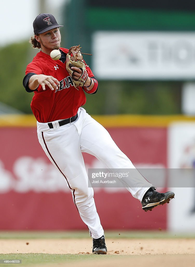 Tim Proudfoot of the Texas Tech Red Raiders warms up prior to the game against the Miami Hurricanes during the Coral Gables Regional at the NCAA...