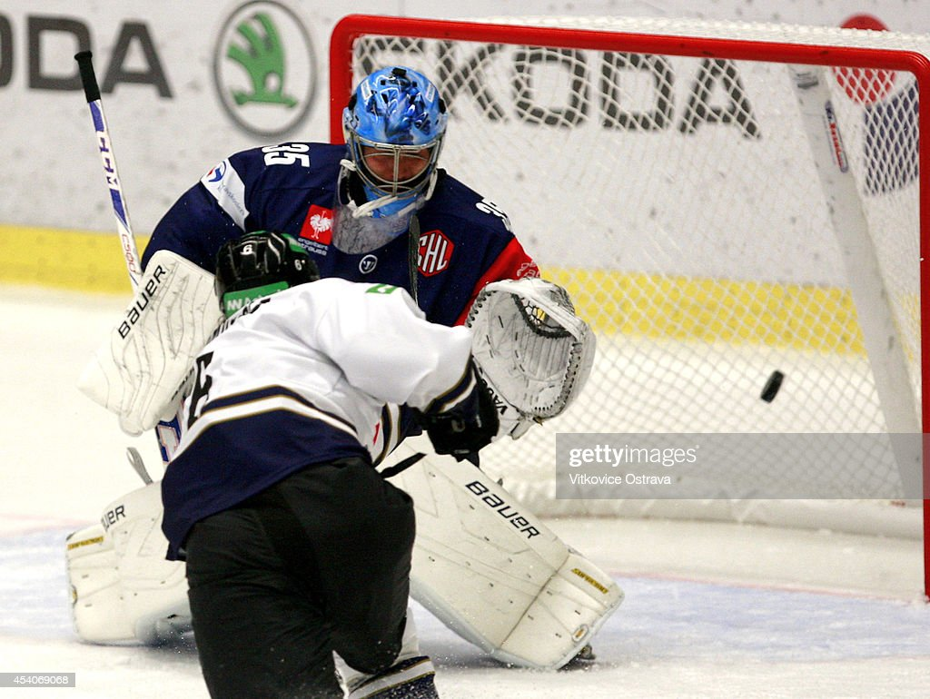 #6 Tim Ramholt of EV Zug scores their second goal past goalkeeper #35 Filip Sindelar of Vitkovice Ostrava during the Champions Hockey League group stage game between Vitkovice Ostrave and EV Zug on August 23, 2014 in Ostrava, Czech Republic.