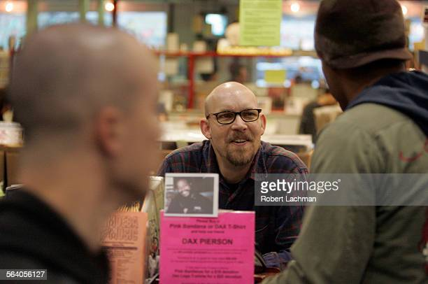 Tim Ranow answers customers questions at the information desk at Amoeba Music along Sunset Blvd in Hollywood which relies on a knowledgeable staff...