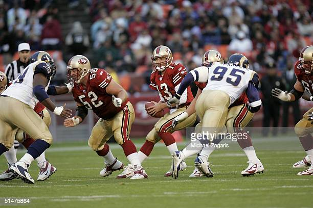 Tim Rattay of the San Francisco 49ers drops back to pass as Brock Gutierrez blocks against the St Louis Rams at Monster Park on October 3 2004 in San...