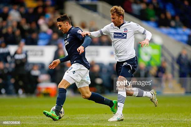 Tim Ream of Bolton in action with Lee Gregory of Millwall during the Sky Bet Championship match between Bolton Wanderers and Millwall at the Macron...
