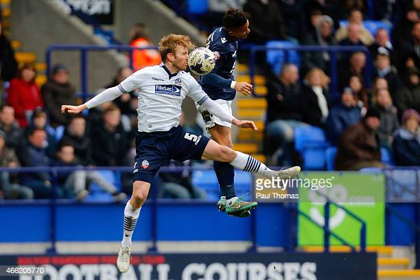 Tim Ream of Bolton in action with Paris CowanHall of Millwall during the Sky Bet Championship match between Bolton Wanderers and Millwall at the...