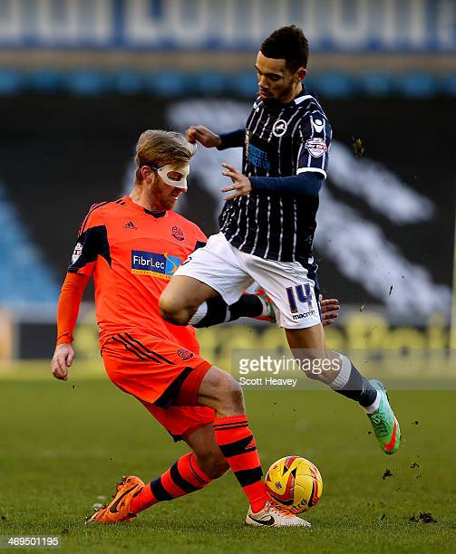 Tim Ream of Bolton tackles Ryan Fredericks of Millwall during the Sky Bet Championship match between Millwall and Bolton Wanderers at The Den on...