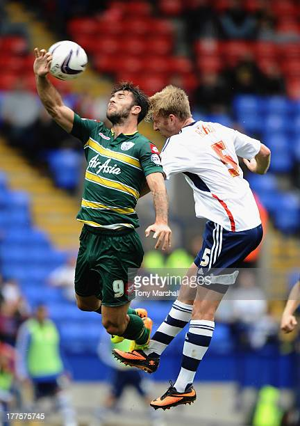 Tim Ream of Bolton Wanderers and Charlie Austin of Queens Park Rangers challenge for a header during the Sky Bet Championship match between Bolton...