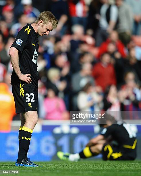 Tim Ream of Bolton Wanderers looks dejected as they are relegated after the Barclays Premier League match between Stoke City and Bolton Wanderers at...