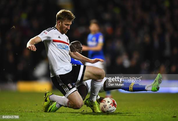 Tim Ream of Fulham and Modou Barrow of Leeds United battle for the ball during the Sky Bet Championship match between Fulham and Leeds United at...