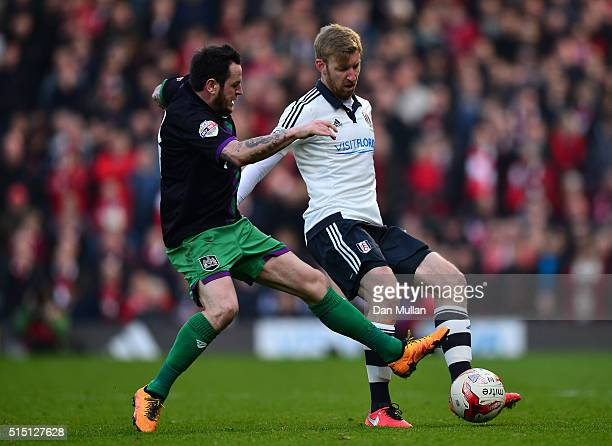Tim Ream of Fulham holds off Lee Tomlin of Bristol City during the Sky Bet Championship match between Fulham and Bristol City at Craven Cottage on...