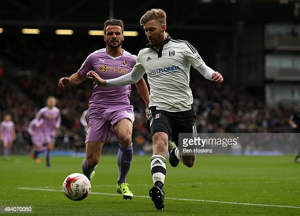 Tim Ream of Fulham holds off pressure from Orlando Sa of Reading during the Sky Bet Championship match between Fulham and Reading on October 24 2015...