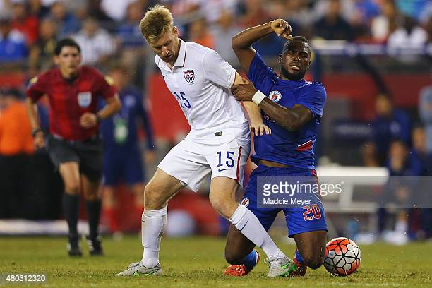 Tim Ream of United States and Sony Norde of Haiti battle for the ball during the 2015 CONCACAF Gold Cup Group A match between United States and Haiti...