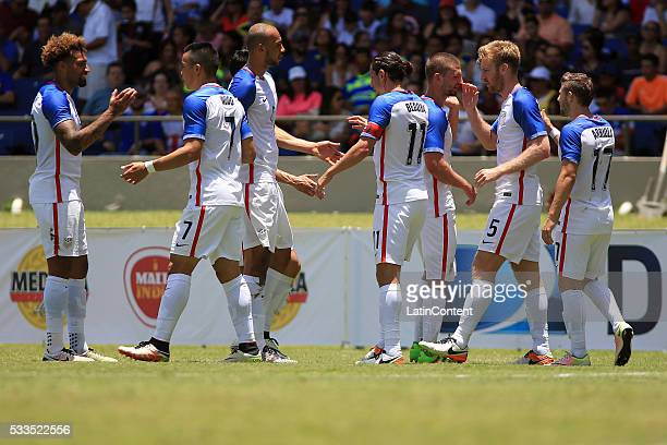 Tim Ream of USA celebrates with teammates after scoring the opening goal during an international friendly match between Puerto Rico and USA at Juan...