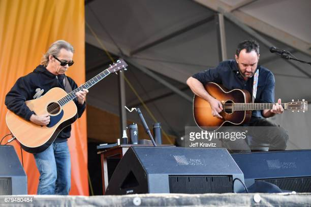 Tim Reynolds and Dave Matthews perform onstage during day 5 of the 2017 New Orleans Jazz Heritage Festival at Fair Grounds Race Course on May 5 2017...
