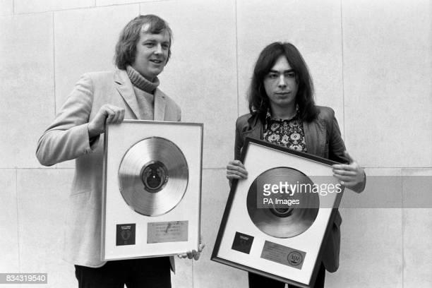 Tim Rice and Andrew Lloyd Webber proudly show gold and platinum albums of their rock opera Jesus Christ Superstar which they received at Inn on the...