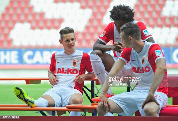 Tim Rieder Caiuby Francisco da Silva and Tim Matavz wait for the team presentation of FC Augsburg at SGL Arena on July 16 2014 in Augsburg Germany