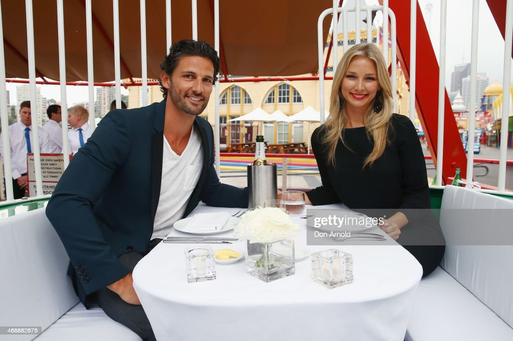 Tim Robards and Anna Heinrich pose inside a cabin on the ferris wheel during Luna Park's 2014 Valentine's event at Luna Park on February 12, 2014 in Sydney, Australia.