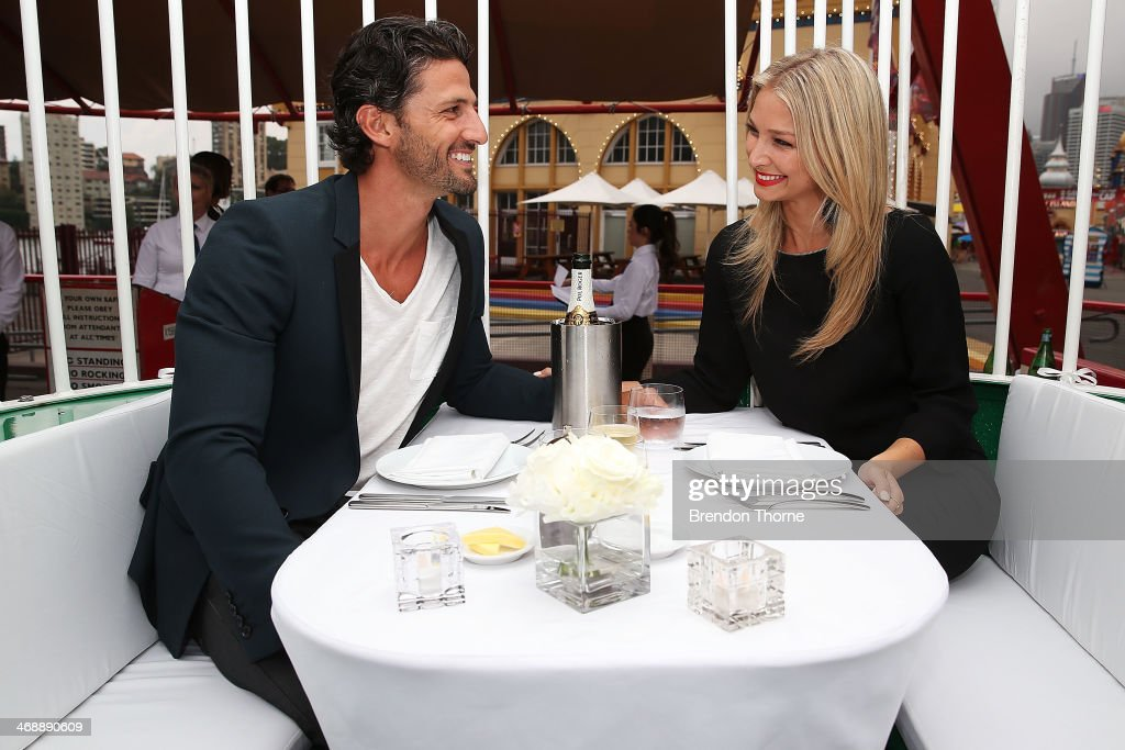 Tim Robards and Anna Heinrich pose inside a ferris wheel cabin during Luna Park's 2014 Valentine's event at Luna Park on February 12, 2014 in Sydney, Australia.