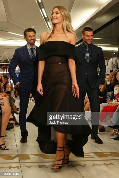 Tim Robards Jennifer Hawkins and Kris Smith showcase designs during the Myer Fashion Runway show on March 17 2017 in Melbourne Australia